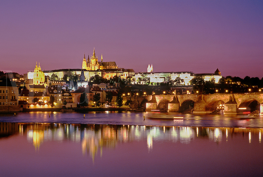 Scenic view of the castle and St. Vitus Cathedral of Prague reflected in the Vltava river at dusk. Prague, Bohemia, Czech Republic.