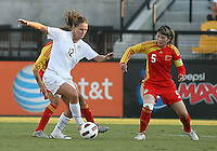 Lauren Cheney #12 of the USA WNT keeps the ball from Xinzhi Weng #5 of the PRC WNT during an international friendly match at KSU Soccer Stadium, on October 2 2010 in Kennesaw, Georgia. USA won 2-1.