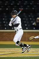Cole McNamee (40) of the Wake Forest Demon Deacons follows through on his swing against the Florida State Seminoles at David F. Couch Ballpark on March 9, 2018 in  Winston-Salem, North Carolina.  The Seminoles defeated the Demon Deacons 7-3.  (Brian Westerholt/Four Seam Images)