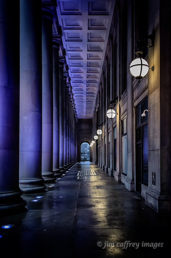 The Portico of Chicago's Union Station in early evening lit by purple floodlights.