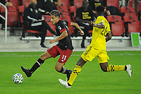 WASHINGTON, DC - OCTOBER 28: Yamil Asad #11 of D.C. United battles for the ball with Fatai Alashe #26 of Colubmus Crew SC during a game between Columbus Crew and D.C. United at Audi Field on October 28, 2020 in Washington, DC.
