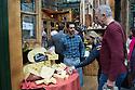 London, UK. 25.10.2014. Male stallholder talking to customers sampling cheese at Borough Market, Southwark. Photograph © Jane Hobson.
