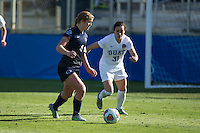 Cary, North Carolina - Sunday December 6, 2015: Megan Schafer (4) of the Penn State Nittany Lions dribbles the ball past Christina Gibbons (31) of the Duke Blue Devils during second half action at the 2015 NCAA Women's College Cup at WakeMed Soccer Park.  The Nittany Lions defeated the Blue Devils 1-0.