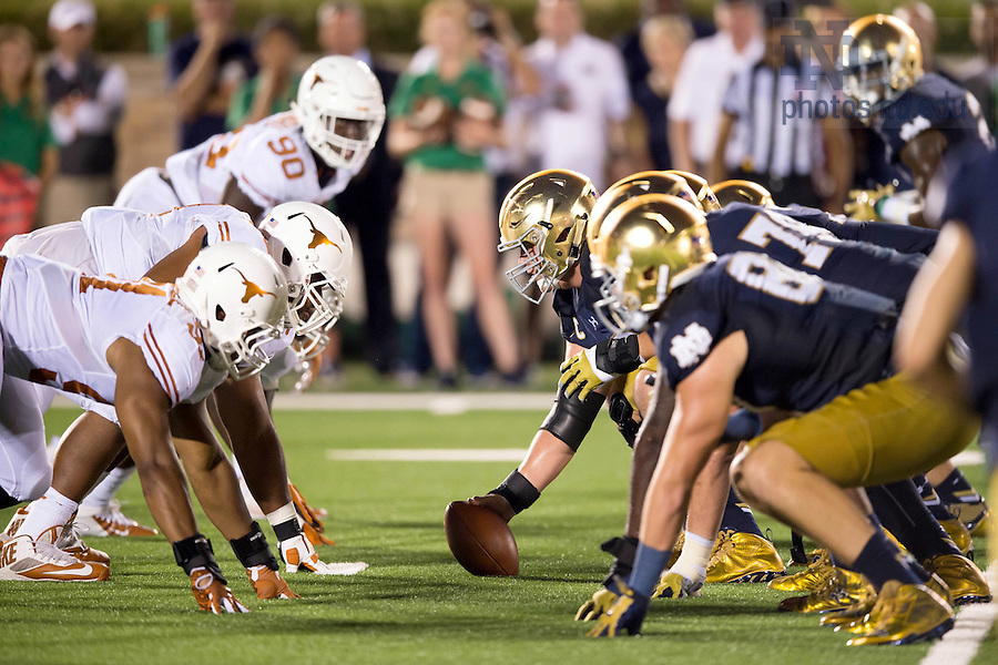 Sept. 5, 2015; The Irish and the Longhorns square off on the line of scrimmage. Notre Dame defeated Texas 38-3. (Photo by Matt Cashore)