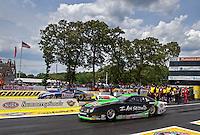 Jun. 2, 2013; Englishtown, NJ, USA: NHRA pro stock driver Mike Edwards (near lane) races alongside Jason Line during the Summer Nationals at Raceway Park. Mandatory Credit: Mark J. Rebilas-