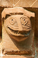 Norman Romanesque exterior corbel no 37 - sculpture of a grotesque head with interlocking teeth. The Norman Romanesque Church of St Mary and St David, Kilpeck Herefordshire, England. Built around 1140