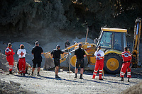 Pictured: Forensic archaeologists and Hellenic Red Cross volunteers, assisted by a digger, go through soil at the site where Ben Needham disappeared from in Kos, Greece. Friday 14 October 2016<br />Re: Police teams led by South Yorkshire Police are searching for missing toddler Ben Needham on the Greek island of Kos.<br />Ben, from Sheffield, was 21 months old when he disappeared on 24 July 1991 during a family holiday.<br />Digging has begun at a new site after a fresh line of inquiry suggested he could have been crushed by a digger.