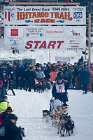 Jessie Royer team leaves the start line during the restart day of Iditarod 2009 in Willow, Alaska