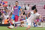 FC Barcelona's Sergio Busquets (l) and Getafe CF's Nemanja Maksimovic during La Liga match. August 29, 2021. (ALTERPHOTOS/Acero)