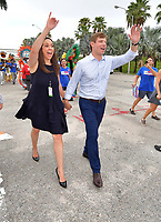 MIAMI, FLORIDA - JUNE 27: Eric Michael Swalwell Jr. is an American politician serving as the U.S. Representative for California's 15th congressional district since 2013, seen here with his wife prior to the debate on the second night of the first 2020 Democratic presidential debate. A field of 20 Democratic presidential candidates was split into two groups of 10 for the first debate of the 2020 election, taking place over two nights at Knight Concert Hall of the Adrienne Arsht Center for the Performing Arts of Miami-Dade County on June 27, 2019 in Miami, Florida<br /> <br /> <br /> People:  Eric Swalwell, Brittany Watts-Swalwell