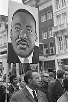 Remembrance tour in Amsterdam, HOLLAND,<br />  for Martin Luther King,April 6, 1968.<br /> <br /> The procession passes through the city with large photos of Martin Luther King who had be recently murdered.<br /> <br /> Photographer Nijs, Jac. de / Anefo