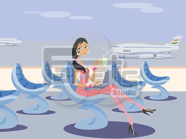 Businesswoman working on a laptop at an airport lounge