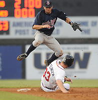 July 15, 2009: Shortstop Brian Dozier (15) of the Elizabethton Twins goes high over sliding Robbie Hefflinger (33) for the putout at second base in a game at Dan Daniel Memorial Park in Danville, Va. Photo by:  Tom Priddy/Four Seam Images