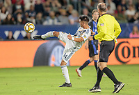 CARSON, CA - SEPTEMBER 21: Joe Corona #14 of the Los Angeles Galaxy crosses a ball during a game between Montreal Impact and Los Angeles Galaxy at Dignity Health Sports Park on September 21, 2019 in Carson, California.