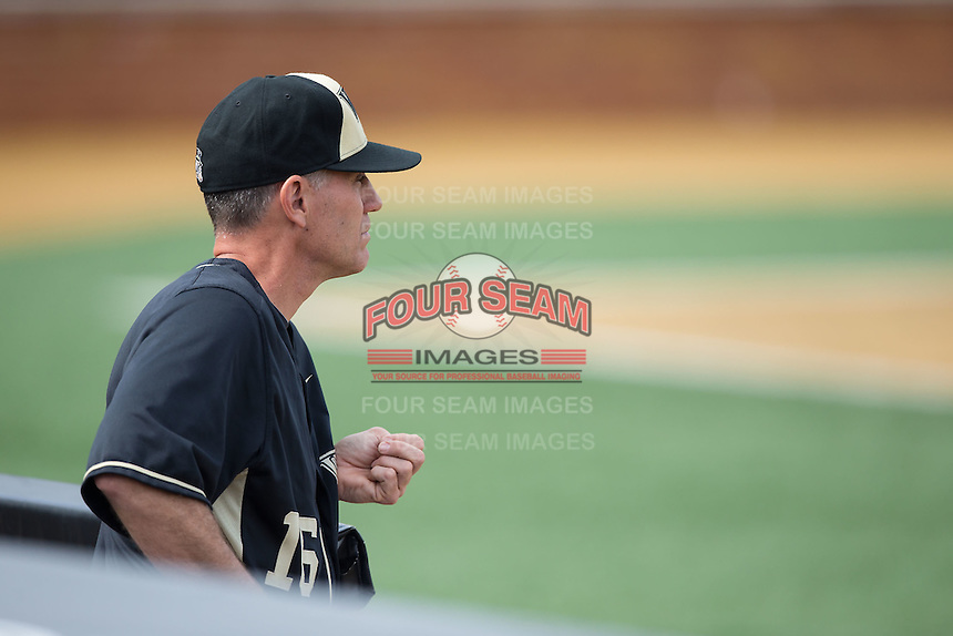 Wake Forest Demon Deacons head coach Tom Walter (16) watches from the dugout during the game against the Miami Hurricanes at Wake Forest Baseball Park on March 22, 2015 in Winston-Salem, North Carolina.  The Demon Deacons defeated the Hurricanes 10-4.  (Brian Westerholt/Four Seam Images)