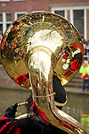 A Black Pete, one of Sinterklaas helpers, plays the Sousaphone to welcome Sinterklass to Utrecht, the Netherlands
