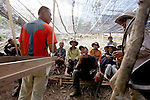 Capt. Jessie Lee chats with local villagers during a break at a JPAC dig site near Ta Oy, Laos on Wednesday, November 7, 2012. The recovery team is searching for the remains of an American Marine unaccounted for from the Vietnam war. (Star-Telegram/Khampha Bouaphanh)