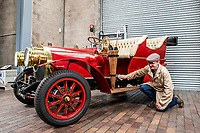 BNPS.co.uk (01202 558833)<br /> Pic: MaxWillcock/BNPS<br /> <br /> Pictured: National Motor Museum's Ben Wanklyn cleans Mr Toad's car.<br /> <br /> Mr Toad's car from Wind in the Willows has gone on display after a painstaking restoration following years of neglect.<br /> <br /> The vehicle was made for the 1996 film adaptation of Kenneth Grahame's classic 1908 children's book starring Terry Jones as the obsessive amphibian.<br /> <br /> The car, which appears to be from the Edwardian era, was actually built in 1995 at Shepperton Studios for the film.<br /> <br /> Following the film's release, it was transported to America, where it spent many years hanging from the ceiling of a Florida restaurant.<br /> <br /> It was brought back to Britain last year in a dilapidated state and has been restored at the National Motor Museum workshop in Beaulieu, Hants, where visitors can see it driven around the grounds.