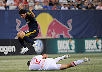 Alecko Eskandarian (11) of the Los Angeles Galaxy jumps over a tackle by Mike Petke (12) of the New York Red Bulls. The Los Angeles Galaxy defeated the New York Red Bulls 3-1 during a Major League Soccer match at Giants Stadium in East Rutherford, NJ, on July 16, 2009.