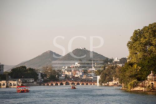 Udaipur, Rajasthan,  India. View over the water to the Daiji bridge, Lake Pichola.