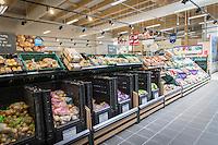 Fresh produce displayed on supermarket shelving