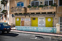 Malta, Bugibba, Northern region of Malta.<br /> <br /> In the winter a quiet tourist area with mainly older overwintering English tourists.  Many places are closed and lots of appartments are boarded up.<br /> Here property for sale with a supermarket and restaurant permit.<br /> <br /> Photo Kees Metselaar
