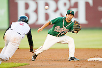 Greensboro Grasshoppers shortstop Anthony Gomez (2) waits for the throw as Tim Anderson (2) of the Kannapolis Intimidators is caught trying to steal second base at CMC-Northeast Stadium on July 12, 2013 in Kannapolis, North Carolina.  The Grasshoppers defeated the Intimidators 2-1.   (Brian Westerholt/Four Seam Images)