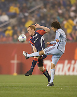 New England Revolution midfielder/defender Jeff Larentowicz (13) fails to block Colorado Rapids midfielder Mehdi Ballouchy (8) pass. The New England Revolution tied the Colorado Rapids, 1-1, at Gillette Stadium on May 16, 2009.
