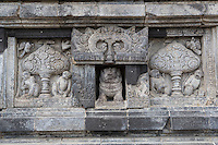 Yogyakarta, Java, Indonesia.  Prambanan Temples.  Carving near Base of Nandi Temple, showing  Kalpataru, the Tree of Heaven.  Note Lion in the central niche. (Missing in  _JAV9910)