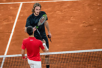 9th October 2020, Roland Garros, Paris, France; French Open tennis, Mens singles semi-final, Roland Garros 2020; Novak Djokovic bottom of Serbia greets Stefan Tsitsipas of Greece after their mens singles semifinal match at the French Open