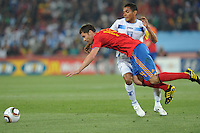 Honduran captain Amado Guevara fouls Spain's Xabi Alonso. Spain defeated Honduras, 2-0, in their second match of play in Group H  in a match played Monday, June 21st, at Ellis Park in Johannesburg, South Africa at the 2010 FIFA World Cup..