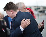 © Joel Goodman - 07973 332324 . 25/09/2016 . Liverpool , UK . A supporter hugs JEREMY CORBYN as he leaves the Museum of Liverpool after The Marr Show , during a round of Sunday morning political interviews from the Docks in Liverpool on the first day of the Labour Party Conference . Photo credit : Joel Goodman