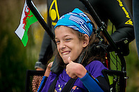 COPY BY TOM BEDFORD<br /> Sunday 26 June 2016<br /> Pictured: Poppy Jones  before the race<br /> Re: A very special father-and-daughter team have tackled the Cardiff Triathlon.<br /> Poppy Jones, 11, who will be competing alongside dad Rob Jones, wants to win the event.<br /> And she's not going to let the fact that she has quadriplegic cerebral palsy , which means she can't sit, stand, roll or support herself, and chronic lung disease stop her.<br /> She will be by Rob's side every step of the way thanks to a cutting-edge wheelchair and boat – for Rob to push or pull – designed especially for the event, which sees participants take part in a swim across Cardiff Bay , a run and a bike ride.