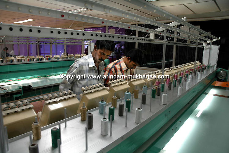 Men at work in Prime Tex embroidery making  factory in Tirupur, Tamilnadu. After lifting of quota system in textile export on 1st january 2005. Tirupur has become the biggest foreign currency earning town of India.