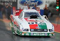 Jan 23, 2009; Chandler, AZ, USA; NHRA funny car driver John Force launches off the starting line during testing at the National Time Trials at Firebird International Raceway. Mandatory Credit: Mark J. Rebilas-