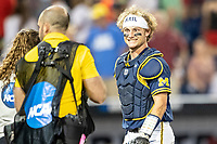 Michigan Wolverines catcher Joe Donovan (0) smiles after Game 6 of the NCAA College World Series against the Florida State Seminoles on June 17, 2019 at TD Ameritrade Park in Omaha, Nebraska. Michigan defeated Florida State 2-0. (Andrew Woolley/Four Seam Images)
