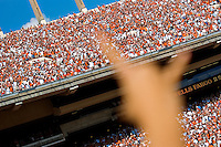 02 September 2006: University of Texas cheerleaders show their school spirit with hook'em horns hand signs as they prepare for their team to take the field prior to the Longhorns' season opener against the University of North Texas at Darrell K Royal Memorial Stadium in Austin, TX.