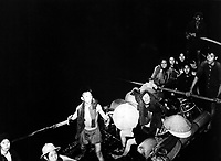 Catholics escaping communist territory in the dead of night smile as they pull alongside French landing craft that will take them to freedom.  Ca.  1954.  (USIA)<br /> EXACT DATE SHOT UNKNOWN<br /> NARA FILE #:  306-PSC-54-17567<br /> WAR & CONFLICT BOOK #:  385