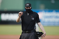 Home plate umpire Mitch Leikam during the game between the Winston-Salem Dash and the Greensboro Grasshoppers at First National Bank Field on June 3, 2021 in Greensboro, North Carolina. (Brian Westerholt/Four Seam Images)