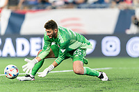 FOXBOROUGH, MA - JULY 7: Ball slips through Alex Bono #25 of Toronto FC during a game between Toronto FC and New England Revolution at Gillette Stadium on July 7, 2021 in Foxborough, Massachusetts.