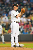 Carolina League All-Star pitcher Dylan Bundy of the Frederick Keys looks to his catcher for the sign against the California League All-Stars during the 2012 California-Carolina League All-Star Game at BB&T Ballpark on June 19, 2012 in Winston-Salem, North Carolina.  The Carolina League defeated the California League 9-1.  (Brian Westerholt/Four Seam Images)