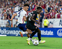 NASHVILLE, TN - SEPTEMBER 5: Antonee Robinson #5 of the United States defends Richie Laryea #22 of Canada during a game between Canada and USMNT at Nissan Stadium on September 5, 2021 in Nashville, Tennessee.