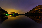 Echo Lake in Franconia Notch State Park of the New Hampshire White Mountains at night during the summer months. Artists Bluff can be see on the left.
