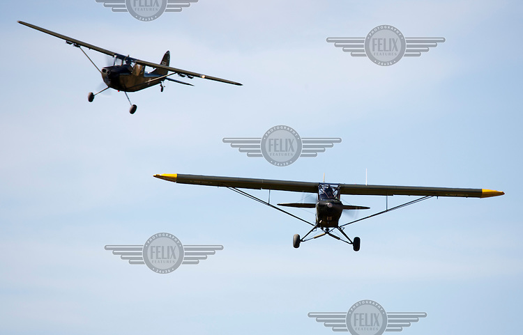 Piper L-18C Super Cub coming in to land, with a Cessna Bird Dog behind. <br /> <br /> Airplanes and reenactors photographed at in connection with Høytorptreffet, an annual event at the Høytorp fort. <br /> <br /> Høytorp fort is a barrage fort in the Glomma defence line, built 1912-17. On April 13th and 14th 1940 the fort was in combat against German army units . It is now protected as a national monument.<br /> <br /> ©Fredrik Naumann/Felix Features