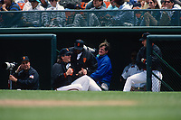 SAN FRANCISCO, CA:  Photographers Eric Risberg and Scott Clarke photograph from the dugout while San Francisco Giants manager Dusty Baker jokes with pitcher John Burkett during a game at Candlestick Park in San Francisco, California on May 9, 1994. (Photo by Brad Mangin)