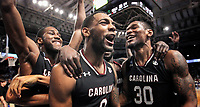 South Carolina Gamecocks Justin McKie, Sindarius Thornwell and Chris Silva celebrate their upset win over Duke during the second round of the NCAA college basketball tournament in Greenville. (Travis Bell/SIDELINE CAROLINA)