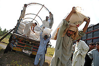 Food and other aid is unloaded at the Swabi Refugee camp. The camp is run by Red Cross/Red Crescent (ICRC), and currently houses around 18,000 refugees. The Pakistani government began an offensive against the Taliban in the Swat Valley in April 2009, which led to a major humanitarian crisis. Up to two million civilians were estimated to have been displaced by the fighting.