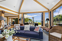BNPS.co.uk (01202) 558833<br /> Pic: MarchandPetit/BNPS<br /> <br /> Pictured: The living room with panoramic views.<br /> <br /> A stunning contemporary home just a stone's throw from an idyllic beach is on the market for £3.85m.<br /> <br /> The aptly-named Beach House was designed to take advantage of its breath-taking views over North Sands Beach and out to sea.<br /> <br /> The four-bedroom oak-framed house is in a fantastic plot in one of the most sought after locations in Salcombe, Devon.<br /> <br /> As well as an expansive balcony to enjoy the views, it also has boat storage - a rarity in the town.