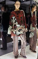 Model in Look 13:  Rustic Vine Dress, Suitung Stripe Pant