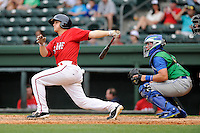 Catcher Jake Romanski (12) of the Greenville Drive bats in a game against the Lexington Legends on Sunday, April 27, 2014, at Fluor Field at the West End in Greenville, South Carolina. The Lexington catcher is Chad Johnson. Greenville won, 21-6. (Tom Priddy/Four Seam Images)